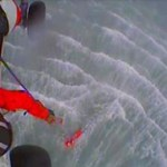 A Coast Guard MH-60 Jayhawk helicopter crew from Forward Operating Location Cordova rescues two fishermen approximately 17 miles southwest of Cordova, Alaska, June 24, 2016. The two fishermen were on the 26-foot fishing vessel Sunrise when it became disabled and adrift near Strawberry Channel. Still image from U.S. Coast Guard video.