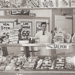Bill Cope (right) and a butcher shop employee pose in 20th Century Market downtown Juneau around 1950. Photo courtesy of Violet Cope and featured on cover of Alaska Economic Trends, July 26, Volume 36 number 7.