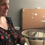 Sarah Owens holds a fish skin bowl by Audrey Armstrong. Kayla Desroches/KMXT