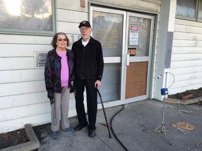 Dr. Bob and Marian Johnson stand in front of the old library building on Mill Bay Rd., previously the A. Holmes Johnson Memorial Library. Kayla Desroches/KMXT