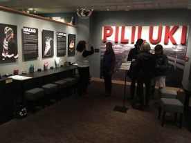 Opening night of the Pililuki exhibit. On the left hand side are the two different types of hats and the booth to create them. Kayla Desroches/KMXT