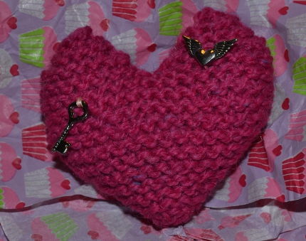 knit heart with charms