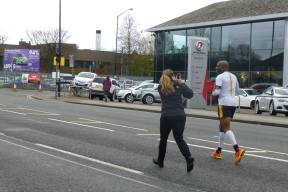 Rosie takes a picture of Kobestarr as he gets towards the end of Manchester Marathon 2014