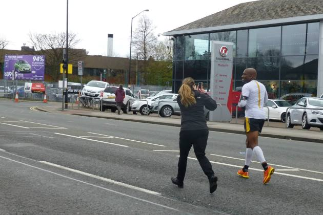 Rosie takes a picture of Kobestarr as he gets towards the end of Manchester Marathon 2014 Staffordshire 70.3 for Kobestarr.com