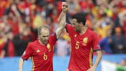 Spain s Andres Iniesta  left  and Sergio Busquets celebrate their side s 1-0 win at the end of the Euro 2016 Group D soccer match between Spain and the Czech Republic at the Stadium municipal in Toulouse  France  Monday  June 13  2016   AP Photo Andrew Medichini