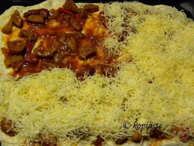 Spetzofai pizza preparation