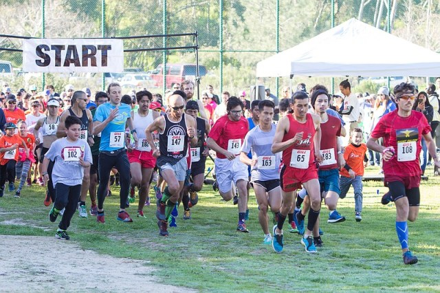 Runners participating in the 5th Annual City Heights Runners' 5K take off fro...
