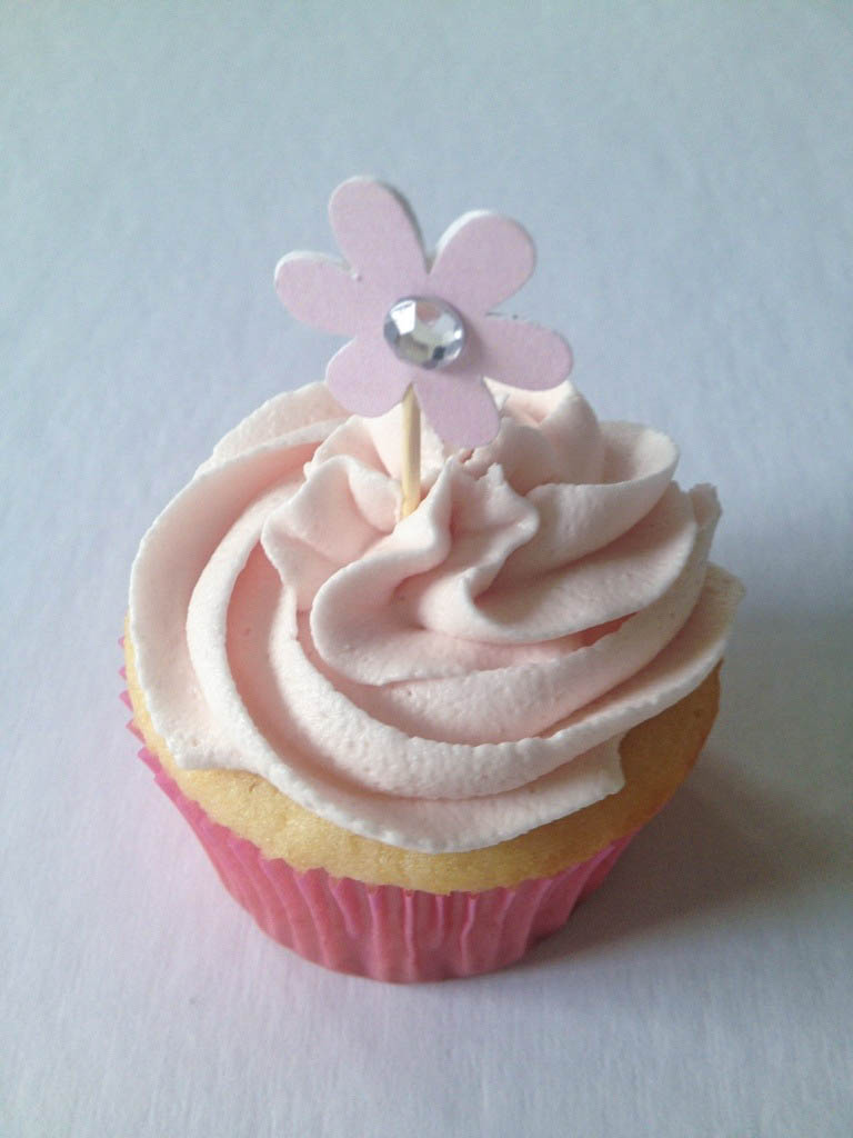 pink cupcake with flower topper