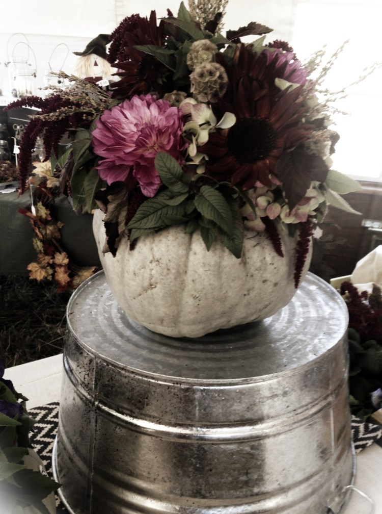 """There was a section with handmade objects. These are some of the decorations surrounding the """"booths"""". This is real pumpkin with live flowers."""