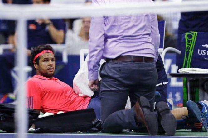 injured opponent. Jo-Wilfried Tsonga