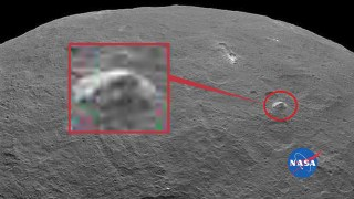 This pyramid shaped mountain rises about three miles from the otherwise flat surrounding surface on Ceres.