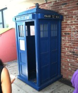 The TARDIS parked outside the shop door, waiting for the Doctor to find her...