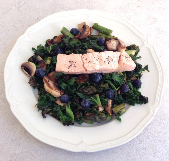 Warm Kale & Blueberry Salad topped with Poached Salmon