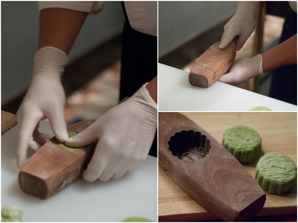 old school wooden mould is used to shape the mooncake