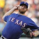 Texas Rangers' Ryan Dempster pitches in the first inning of a baseball game against the Boston Red Sox in Boston, Tuesday, Aug. 7, 2012. (AP Photo/Michael Dwyer)