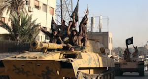 Islamic State group fighters established the capital…