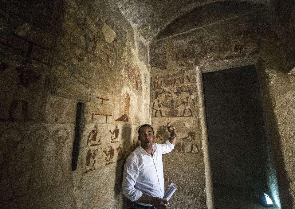 Egyptian archaeologist Abdelgawad Harrbi speaks to the press inside the tomb of Iymery. AFP PHOTO / KHALED DESOUKI (Photo credit should read KHALED DESOUKI/AFP/Getty Images)