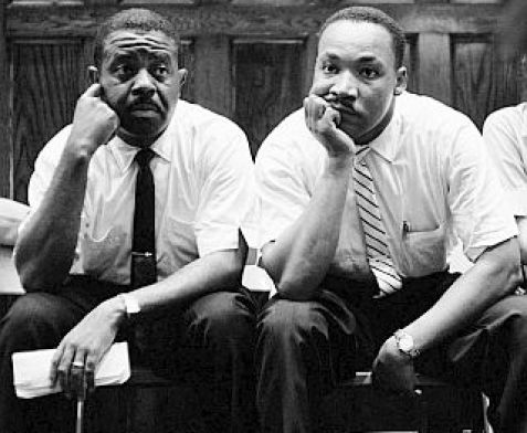 (L-R) Rev. Ralph Abernathy and Rev. Martin Luther King Jr. sit pensively after communicating with Attorney General Robert F. Kennedy while they await protection from the gathered mob outside the First Baptist Church in Montgomery, Alabama. (Photo by Paul Schutzer/Time Life Pictures/Getty Images)