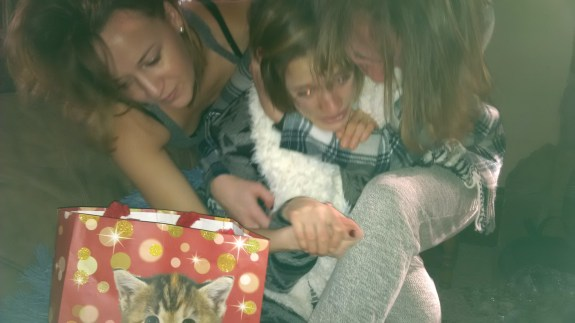 Annual sister pile. My youngest sister has the biggest heart and always starts crying when we are not even through opening our stockings about how fortunate we are, etc. Megan is the sister that comforts her and I am the one that laughs. We all have our parts to play.