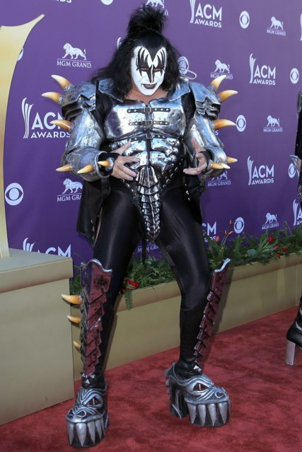 Come to think of it, with the makeup all over his face, the underwear with metal spikes on it in case your husband gets an ideas, the bad hair, and the ugly boots...Gene Simmons should be the mascot for motherhood.....