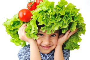 20114515-1206-bigstock_Kid_with_salad_and_tomato_hat__15442769