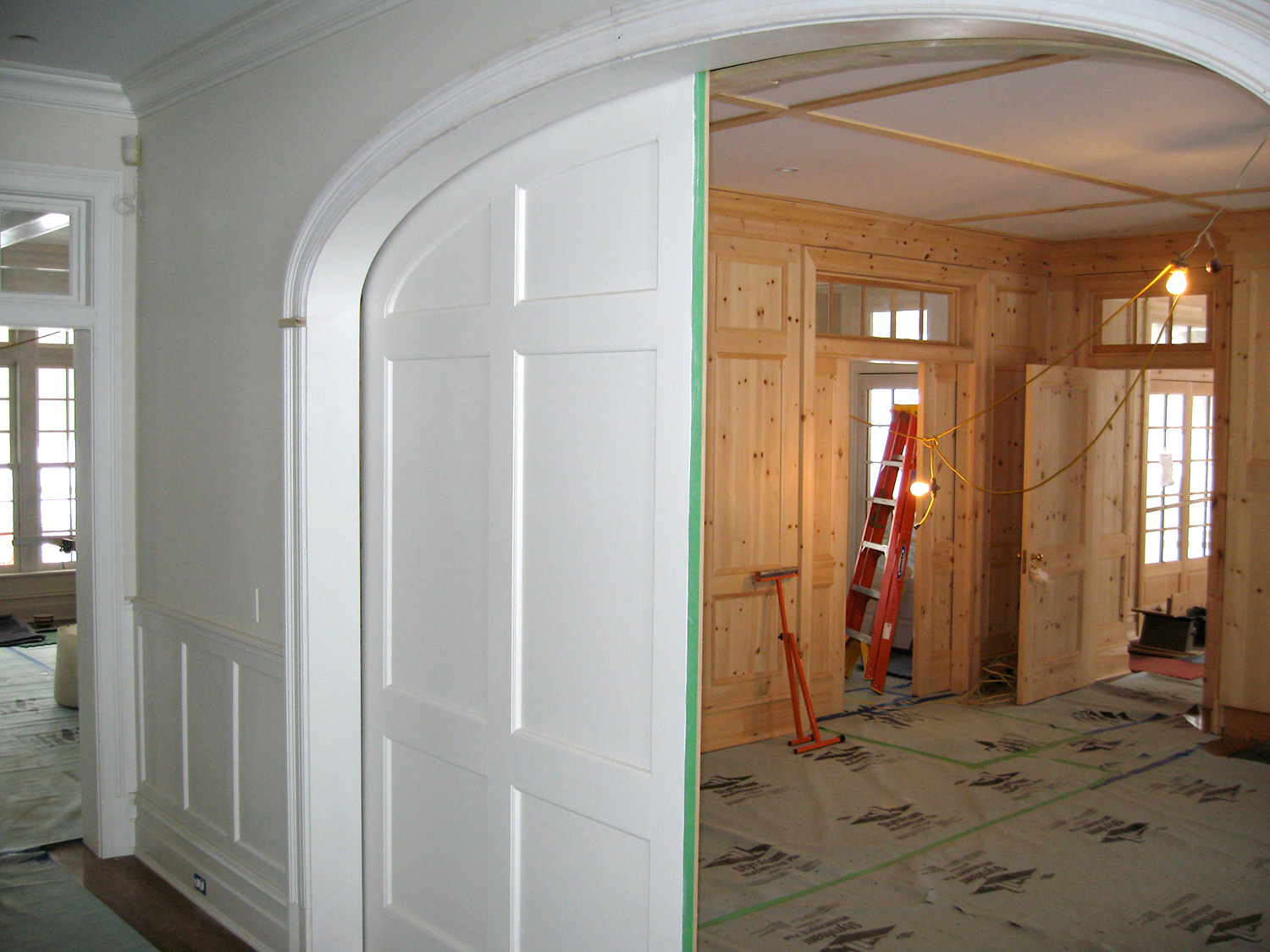 The view looking in to the library. Paint grade panel doors. Hillsdale, NY.