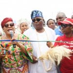 L-R: Representative of Lagos State Governor, APC Women Leader, South West, Chief (Mrs.) Kemi Nelson; Osolo of Isolo, Oba Kabiru Adelaja; Sole Administrator, Isolo LCDA, Hon. Abimbola Oshikoya during the handing over of Lafenwa Panada Street as part of the 114 Roads in Isolo Local Council Development Area