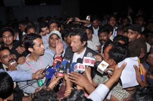 Imran Khan is talking to media after visiting Joesph colony