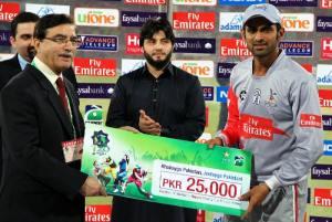 Second semi final Shoaib Malik receiving man of the match award after Sialkot Stallions win against Rawalpindi Rama