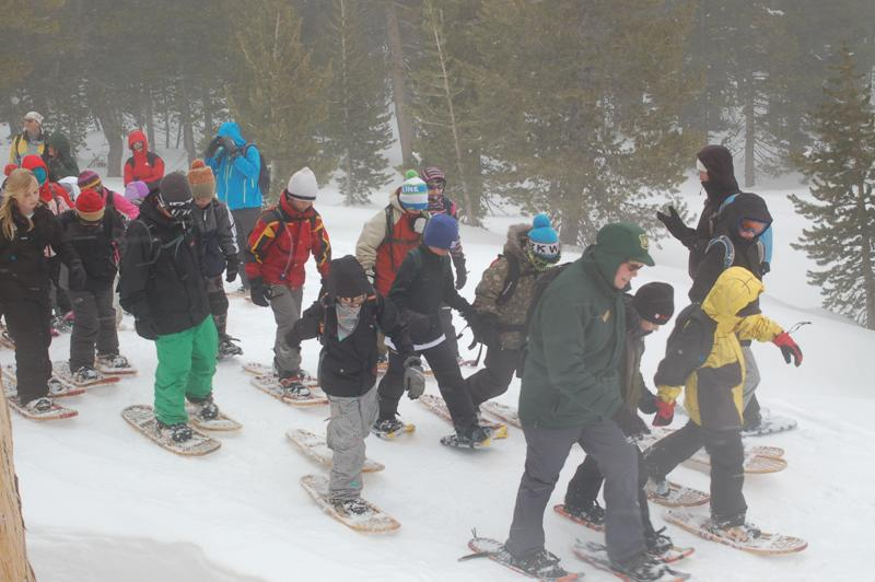 Photo caption:  U.S. Forest Service Ranger Jean Norman leads a group of fifth-graders through the woods during the 2011 Winter Trek environmental education program at Heavenly Ski Resort.  Photo credit:  USFS