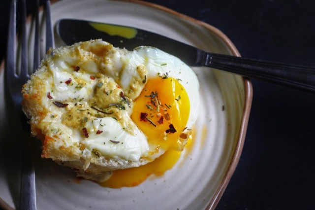 Break toasted in muffin cups..layered with chicken salami,egg, bechamel sauce and cheese..Baked till the egg is perfectly cooked and served with just the slightest sprinkling of mixed herbs!