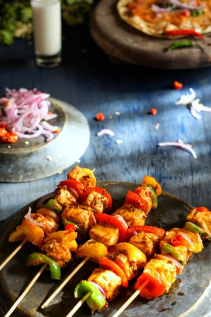 The perfect food for meatless Mondays or just about any party! Perfct, subtely spiced, healthy grilled paneer tikkas!