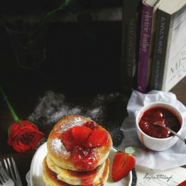 Cottage cheese pancakes stuffed with chocolate and strawberry sauce