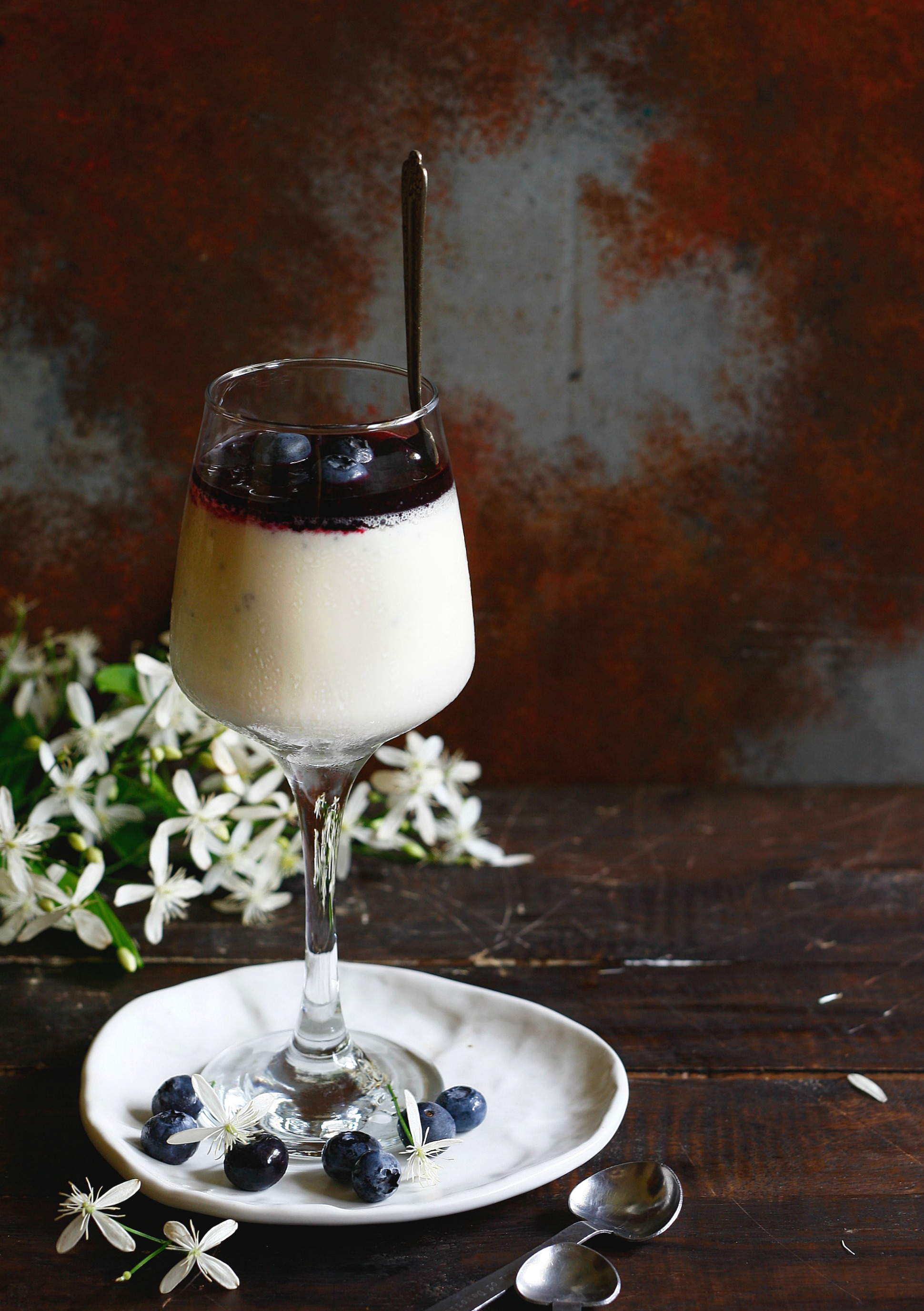 Coconut pannacotta with blueberry gin compote