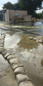 Sandbags were place by Facilities personal to help guide the water into the drains. (Photo Credit: Auto Tech Students)
