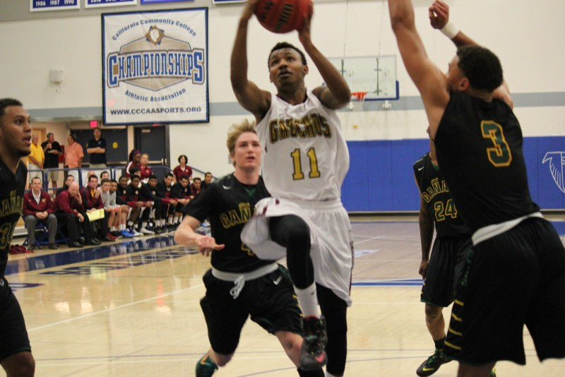 Gauchos guard Maleke Haynes (#11) drives to basket at the California Community College 2015 Championship semifinals at Cerritos College in March. (Photographer Dominic D. Ebel)