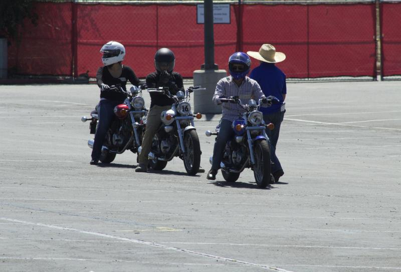 Saddleback's motorcycle students enjoying an empty parking lot while learning the rules of the road. (Photo by Niko LaBarbera)