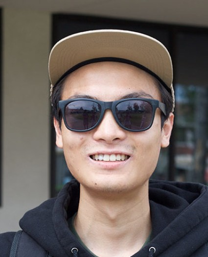 """DANIEL DINH, 20, business major """"This!""""(holding up his phone)"""