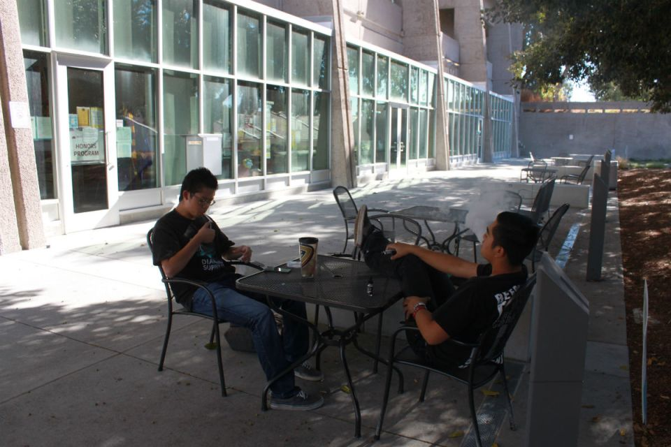 Students Jayvin Fulinara and Tamm Park refuse to stop smoking on campus even if it means getting fined. (Jordan Rangel/Lariat)