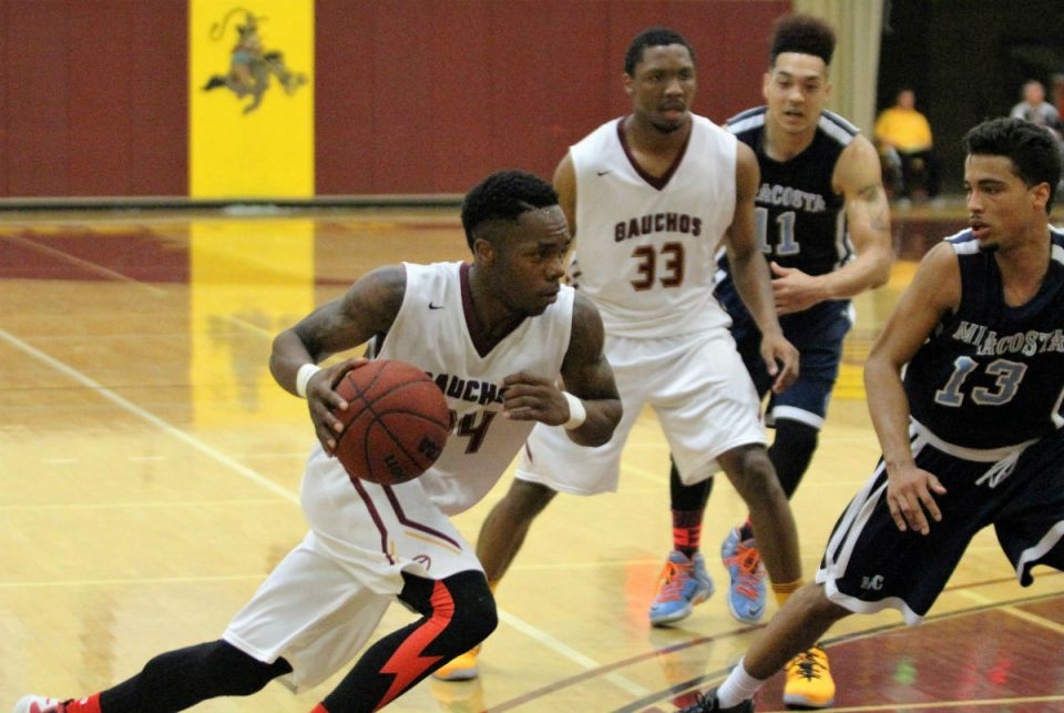 Saddleback guard Devonte Klines (No. 24, white jersey) drives towards the basket, as players look on, against MiraCosta College in Saturday's playoff game. Klines had 17 points, which led the Gauchos for the night. (Nick Nenad/Lariat)