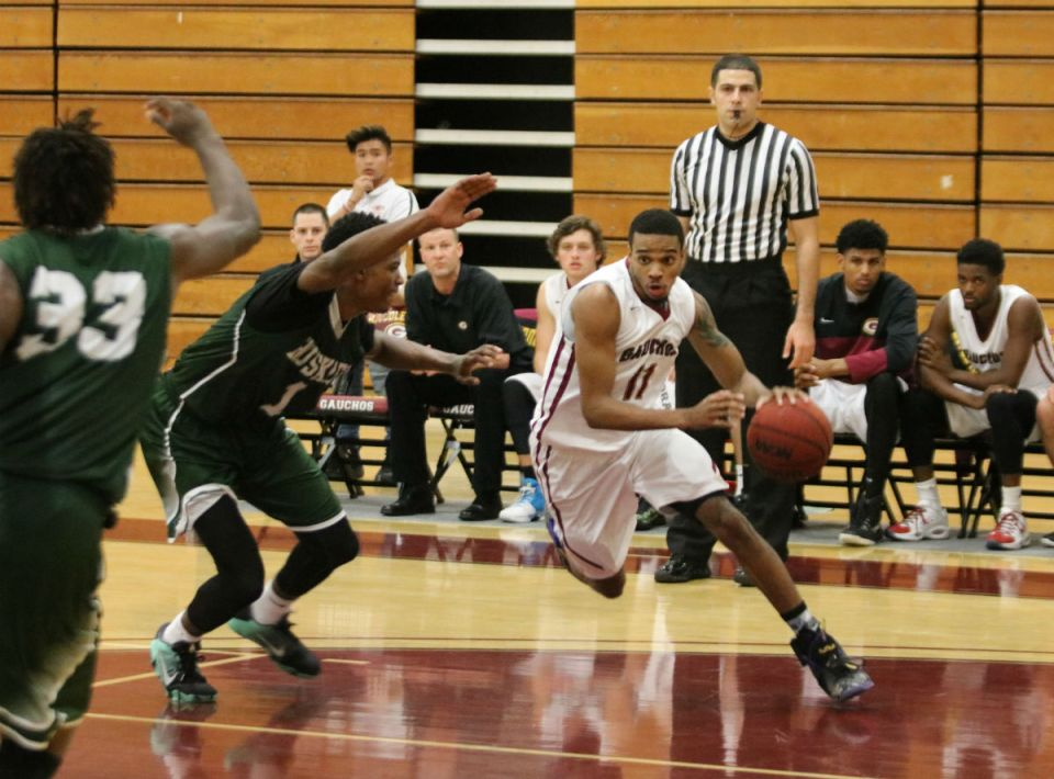 Saddleback guard Charles Trotter (No. 11) drives to the basket while being defended by an ELAC player. The Gauchos have a 30-1 overall record and are currently on a 24-game winning streak. (Nick Nenad/Lariat)