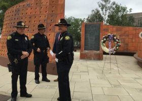 Police officers meet and converse after an emotional 9/11 ceremony. (Mackenzie Quinn/Lariat)