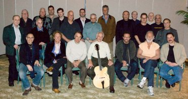group photo of 23 guitarists, including Larry Koonse, at John Pisano Guitar Night Tenth Anniversary Celebration