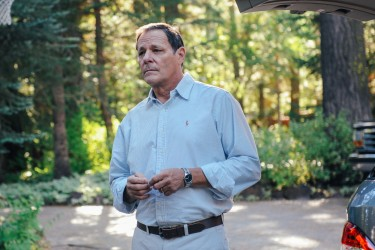 alcolm Green (Chris Mulkey) watching his children leave the family lake house in LAST WEEKEND.