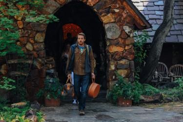 Sean Oakes (Fran Kranz) leaving the family lake house in LAST WEEKEND.