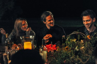 Vanessa Sanford (Alexia Rasmussen), Roger Green (Joseph Cross), and Luke Caswell (Devon Graye) at the family dinner in LAST WEEKEND.