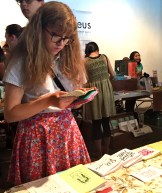 Girl reading mini zine