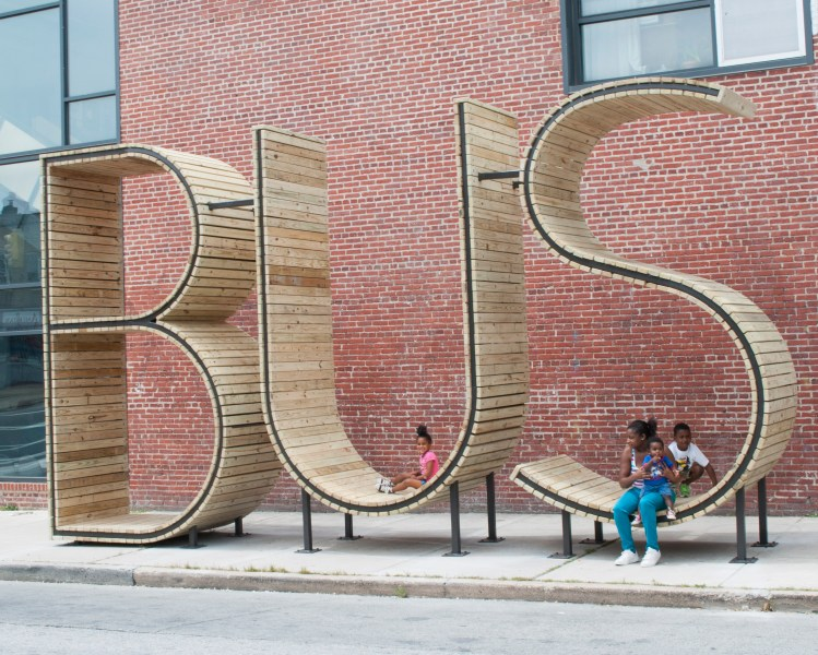 A Sculptural Bus Stop That Spells Out 'Bus' in Giant Letters