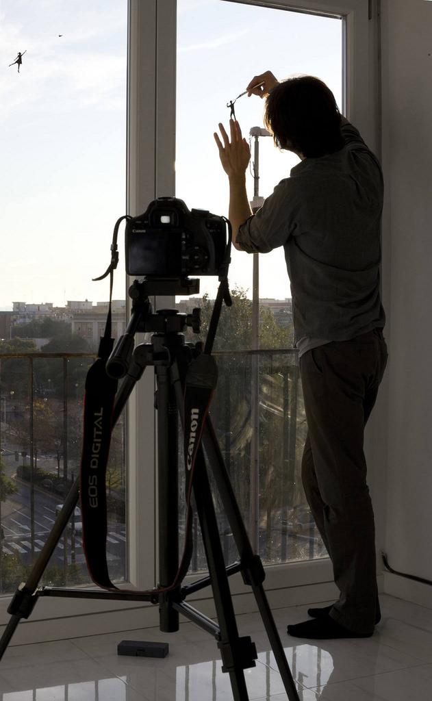 Delightful Silhouette Art on Windows by Pejac