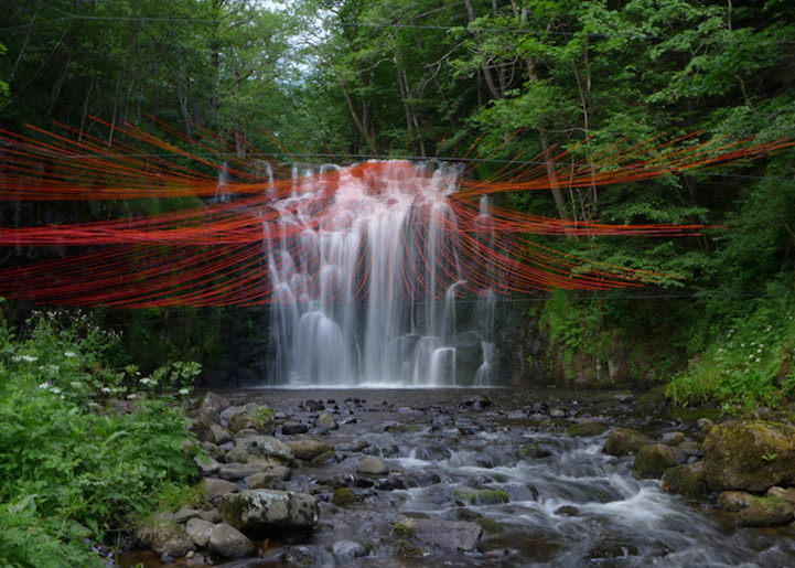 Dripping a beautiful installation of red strings for Waterfall installation